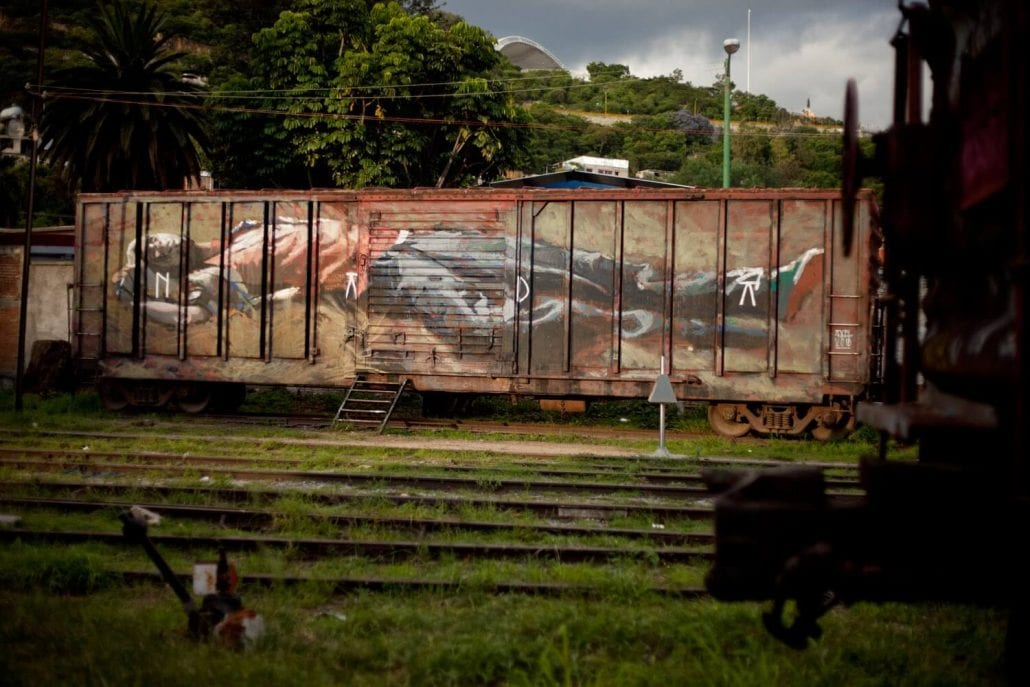 Nada_axel_void_jungle_railroad_track_streetart_graffiti_person_on_old_train